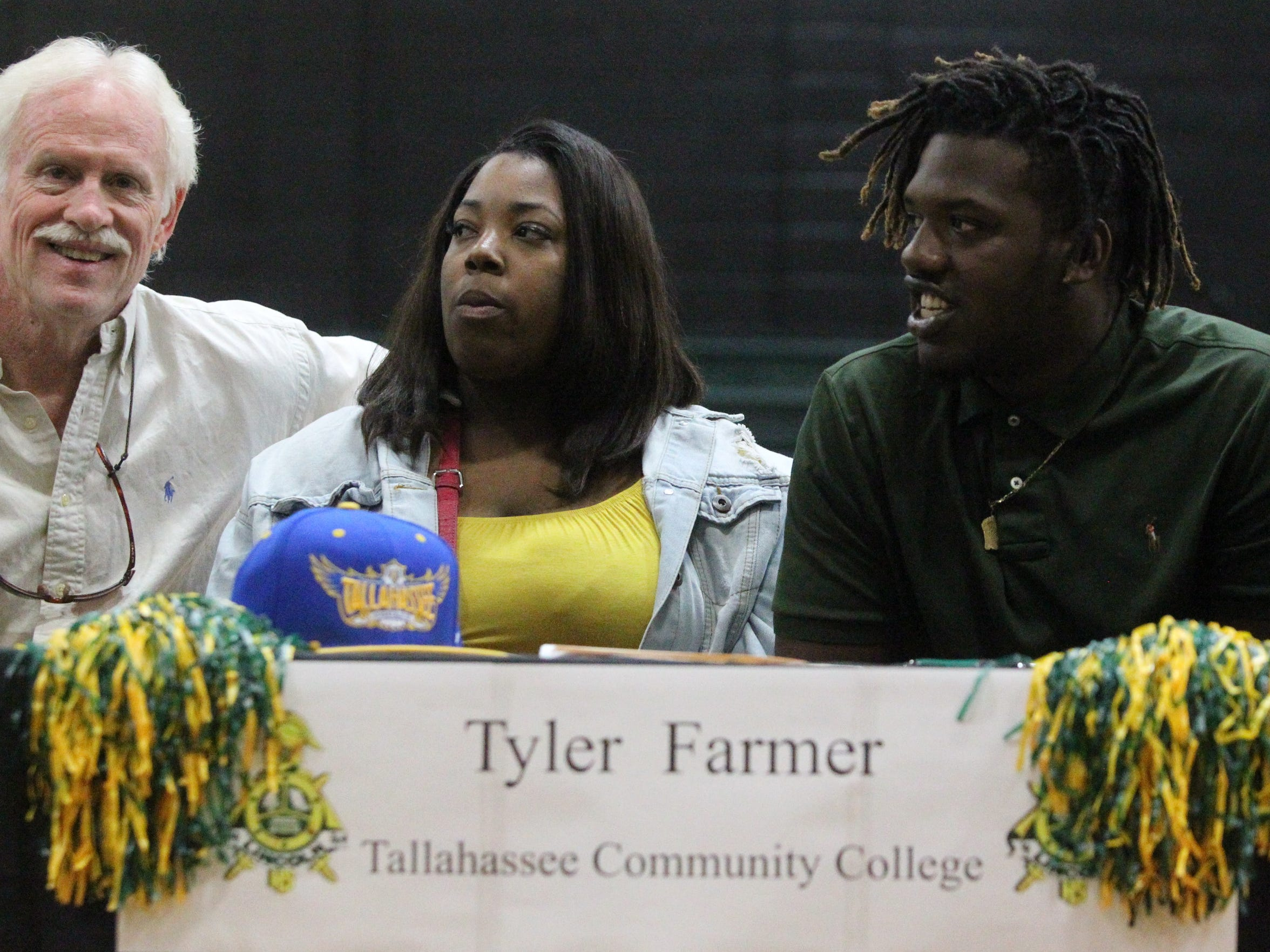 Lincoln High senior Tyler Farmer sits next to his sister
