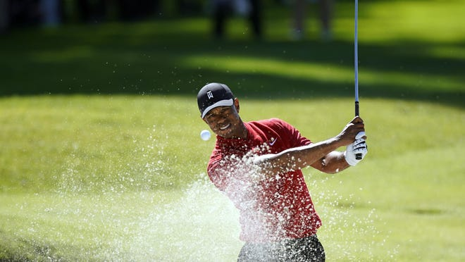 Tiger Woods hits out of a greenside bunker on the 17th hole during the final round of the Genesis Invitational on Feb. 16 at Riviera Country Club in Los Angeles.