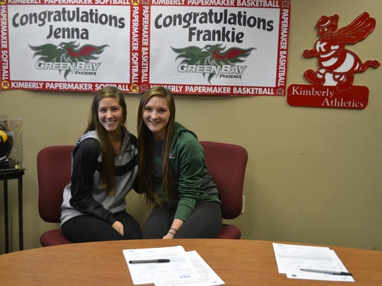 Kimberly High School seniors Jenna Smarzinski, left, and Francesca Wurtz signed national letters of intent at the school Wednesday afternoon, Nov. 12, with University of Wisconsin-Green Bay. Smarzinski will play softball, and Wurtz will play basketball.