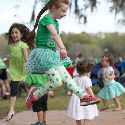 Cameron Broder, 6, center, leaps on the dance floor