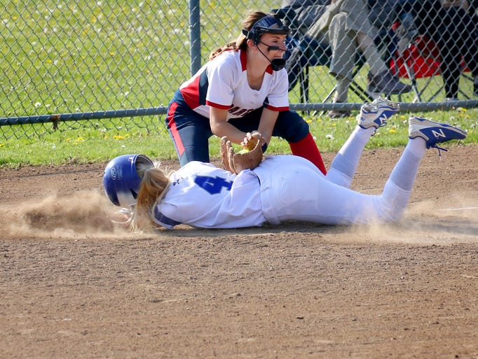 Brookfield Central's Sydney Cain slides in safe at