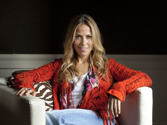 Sheryl Crow posing for a portrait in New York.