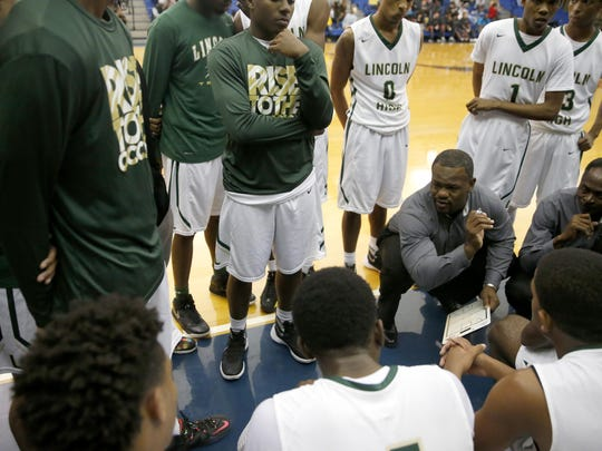 Lincoln coach Dimitric Salters talks to his team during a 2015 Capital City Classic game.