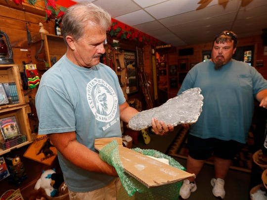 Bigfoot researcher David Bakara opens a box containing a plaster cast of footprints said to be from a Russian Bigfoot at Expedition: Bigfoot! The Sasquatch Museum in Cherry Log, Ga.