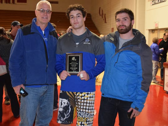 Observerland Upper Weights Most Valuable Wrestler Mitchell Gross of Salem (center) celebrates the honor with his dad, Lee Gross (left) and older brother Tyler Gross (right), a former wrestling standout for the Rocks.