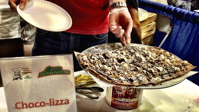 Carlo's Pizza Express, based in Hopewell Junction and Lagrangeville, serve up some chocolate-themed pizza at Hudson Valley Pizza Fest Sunday.