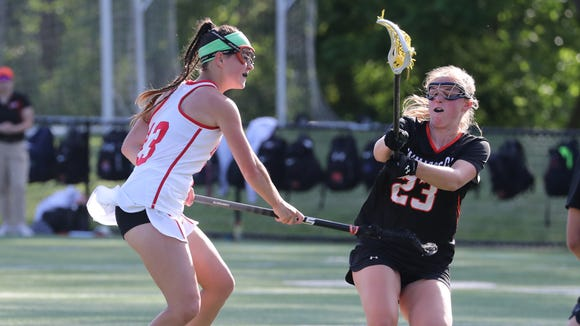 North Rockland's Kerri Gutenberger scores past Mamaroneck defender Emily Mahland during the Section 1 Class A girls lacrosse championship at the Torne Valley Athletic Center May 23, 2018.
