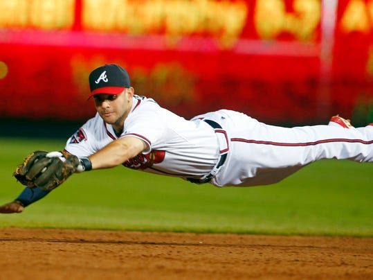 Atlanta Braves second baseman Tommy La Stella (7) makes a diving catch on a ball hit by New York Mets' Daniel Murphy  in the eighth inning of a baseball game in Atlanta, Wednesday, July 2, 2014.  La Stella flipped the ball to second base in time to retire the base runner.  (AP Photo/John Bazemore)