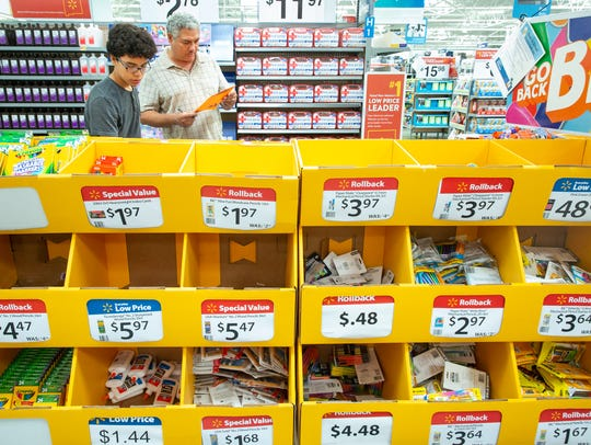 Andres Uribe, 13, shops for school supplies with his