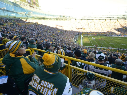 Jules Angel of Rancho Cucamonga, watches the Packers while at her first game at Lambeau Field in Green Bay, Wis. on Sunday, Oct. 18, 2015. Angel has lived with Amyotrophic Lateral Sclerosis, also known as ALS or Lou Gehrig's Disease for seven years this month.