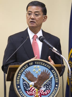 Eric Shinseki, U.S. Secretary of Veterans Affairs, talks with media and attendees at a meeting at the local VA hospital, Indianapolis, Tuesday, Aug. 24, 2010.
