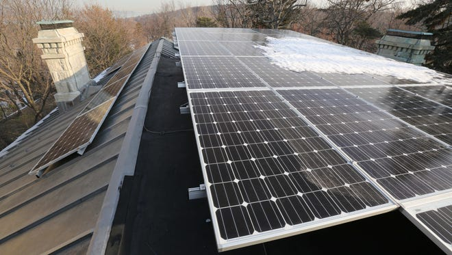 Solar panels on the roof of a villa in Hastings-on-Hudson.