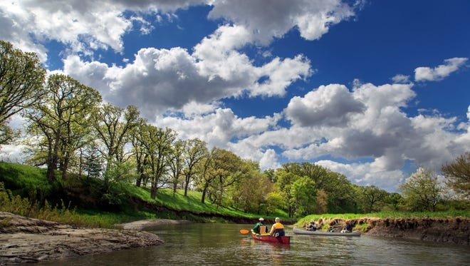 Rex Harvey and Steve Roe, left, and Ray Harden and Ty Smedes paddle down the Raccoon River in Sac County Thursday, May 19, 2016.