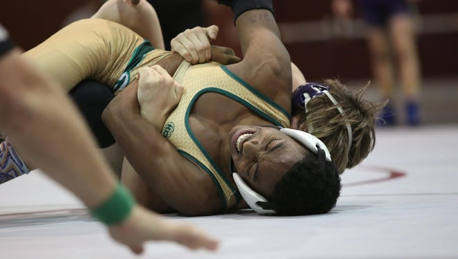 Lincoln's Tyree Young wrestles Columbia's Chace Curtis last year during the District 1-2A finals at 120 pounds.