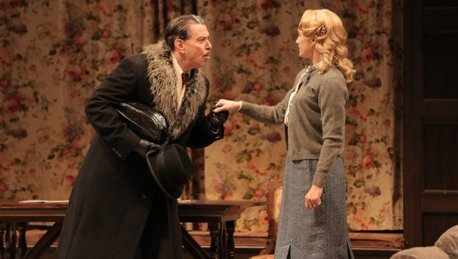 """Mysterious foreigner Mr. Paravicini (Brik Berkes) talks to guest house owner Mollie Ralston (Jenny Strassburg) in ASF's """"The Mousetrap."""""""