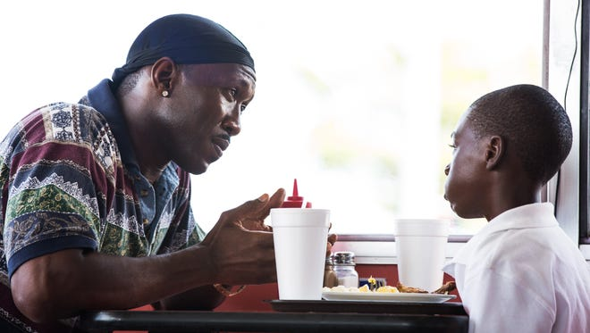 """Juan (Mahershala Ali, left) tries to return some normalcy into the life of Chiron (Alex Hibbert), a young boy with a bad home life, in director Barry Jenkins's """"Moonlight."""""""