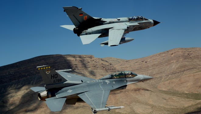 A German air force Tornado and an F-16 Fighting Falcon assigned to the 314th Fighter Squadron fly in formation together during the last joint flying mission at Holloman Air Force Base, Aug. 17, 2017. The GAF has entered its final stage of departure; however, they will not complete their departure from Holloman AFB until mid-2019.