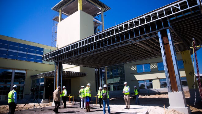 A tour group gathers at the main entrance of the the Lee Health - Coconut Point facility on Friday, March 9, 2018, in Estero. The new facility will feature the only free-standing, 24-hour emergency room in Lee County, outpatient diagnostic and surgery services, primary and specialty physician practices, and Healthy Life Center.