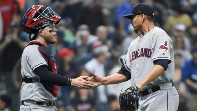 Indians pitcher Carlos Carrasco (right) celebrates with catcher Roberto Perez after beating the Brewers at Miller Park.