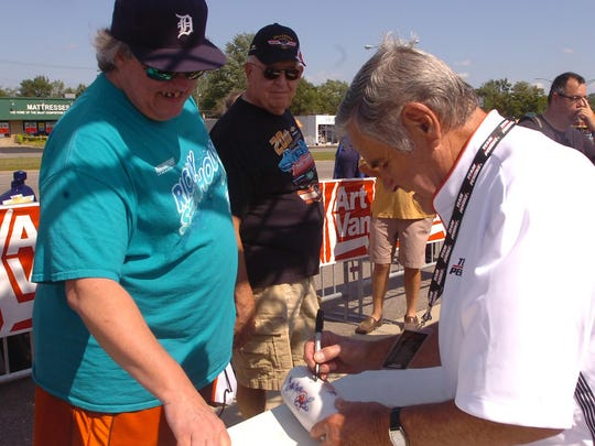 Dave Gola of Roseville gets an autograph from Al Unser.