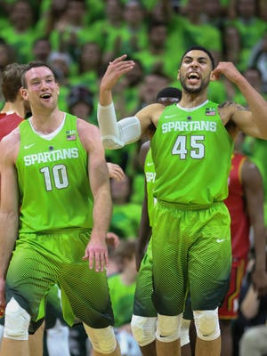 Michigan State Spartans Matt Costello celebrates with Denzel Valentine after the 74-65 win over the Maryland Terrapins on Saturday January 23,2016 at the Breslin Center in East Lansing, MI.