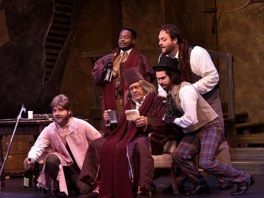 "Scott Purcell (Marcello), Paul Grosvenor (Colline), Randy Messing (Benoit), Jordan Schreiner (Rodolfo) and Jake Stamatis (Schaunard) star in the Tri-Cities Opera production of ""La Bohème."""
