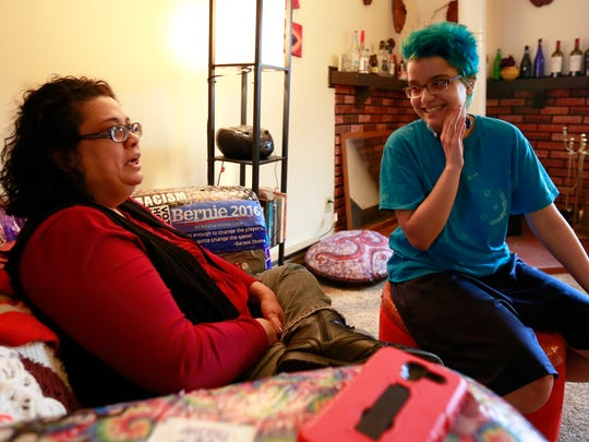 Sam Baum, right, interacts with Baum's mother, Jade Rising, during an interview with USA TODAY NETWORK-Wisconsin reporter Liz Welter Monday at their house in Wisconsin Rapids. T'xer Zhon Kha/USA TODAY NETWORK-Wisconsin