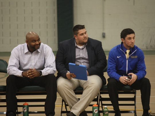 Bobby Naubert (right) watches intently with other coaches as Madonna's first-year junior varsity men's basketball team competes.