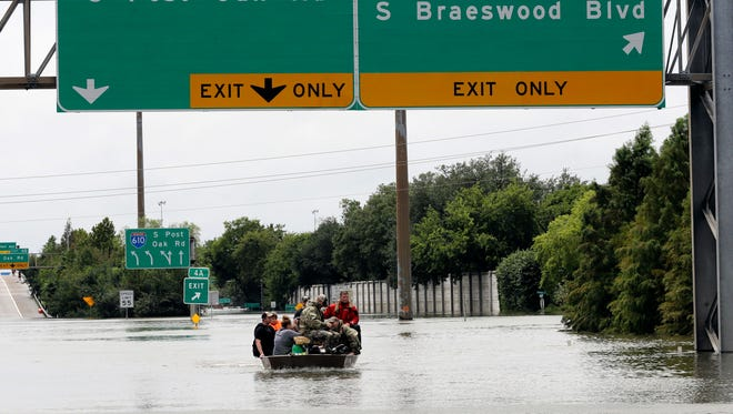 Residents are rescued from their homes surrounded by floodwaters from Tropical Storm Harvey Aug. 27, 2017, in Houston, Texas.