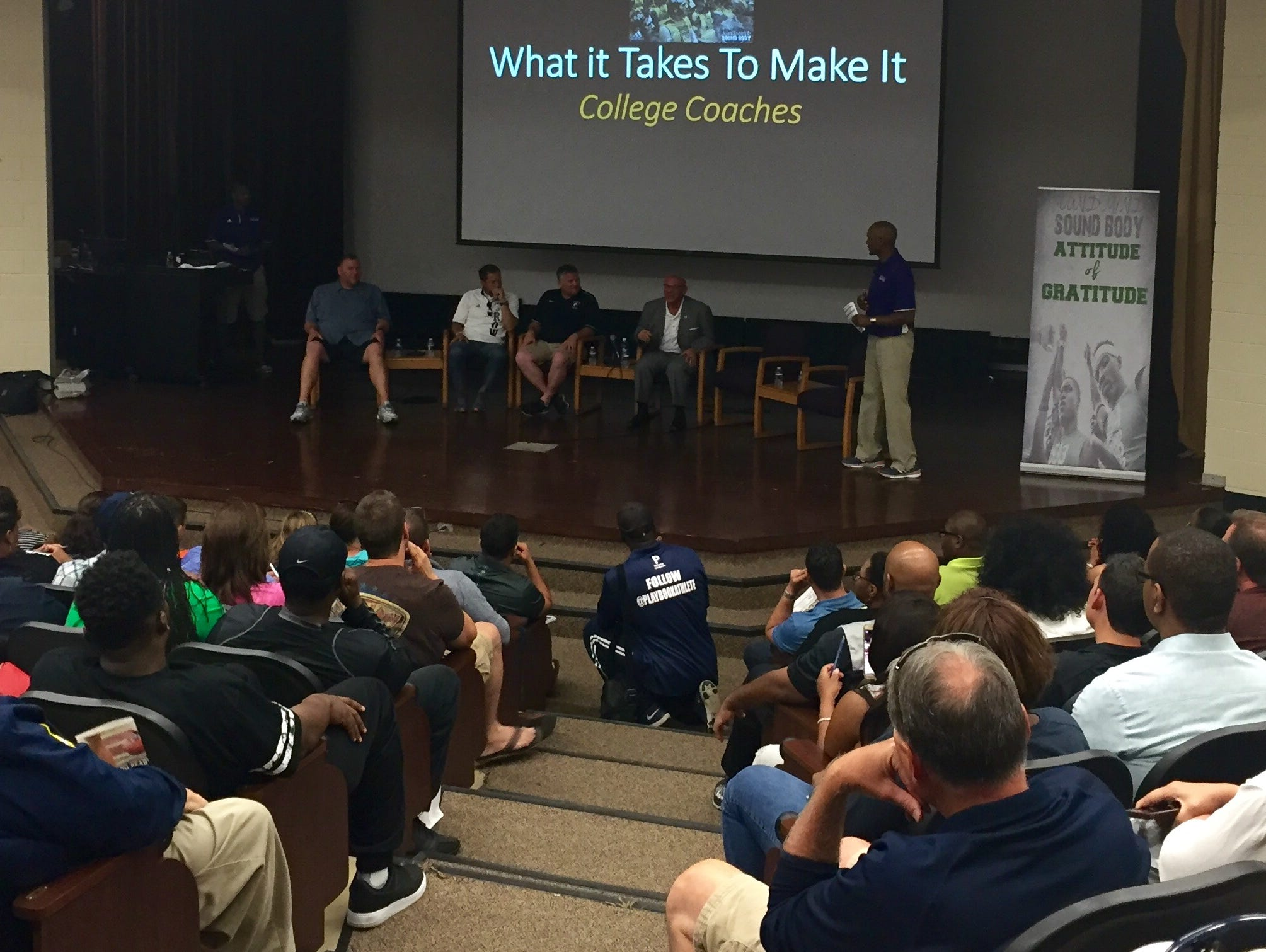 Presenters, including Western Michigan coach P.J. Fleck (white shirt) and Central Michigan coach John Bonamego (second from right) talk during a session in the Sound Mind Sound Body camp Thursday at Wayne State.