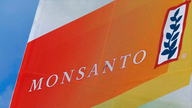 """FILE - In this Monday, Aug. 31, 2015 file photo, the Monsanto logo is seen at the Farm Progress Show in Decatur, Ill. German drug and chemicals company Bayer AG confirmed Thursday, May 19, 2016 it has entered talks with the Monsanto Company about the possible acquisition of the U.S.-based specialist in genetically modified crop seeds.  Leverkusen-based Bayer said in a short statement that its executives had met recently with their Monsanto counterparts """"to privately discuss a negotiated acquisition of Monsanto Company."""""""