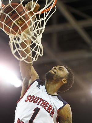 University of Southern Indiana's Jeril Taylor slams home a dunk as the University of Southern Indiana plays Truman State University in the first round of the Great Lakes Valley Basketball Championship Tournament held at the Evansville Ford Center Thursday, March 2, 2017.