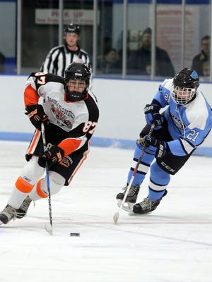 Mamaroneck's Harrison Schreiber moves the puck in front of Suffern's Kyle Foresta during their hockey game at the Hommocks Ice Rink in Larchmont, Jan. 6, 2017.