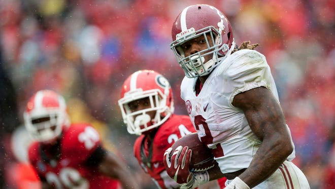 Alabama running back Derrick Henry (2) runs up the middle for a touchdown against Georgia at Sanford Stadium in Athens, Ga. on Saturday October 3, 2015.