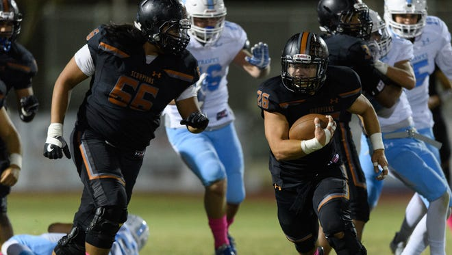 Desert Edge's Rocky Perez (#26) finds plenty of rushing room for a first down in the fourth quarter of their high school football game against Deer Valley on Friday, Oct.20, 2017, at Desert Edge High School in Goodyear, Ariz.