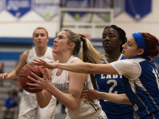 Manaasquan's Lola Mullaney gets past LIncoln players