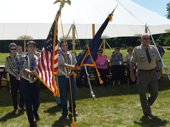 Boy Scout Troop 17 presents the colors at the start of the FDR Library and Museum 75th anniversary commemoration on Thursday.