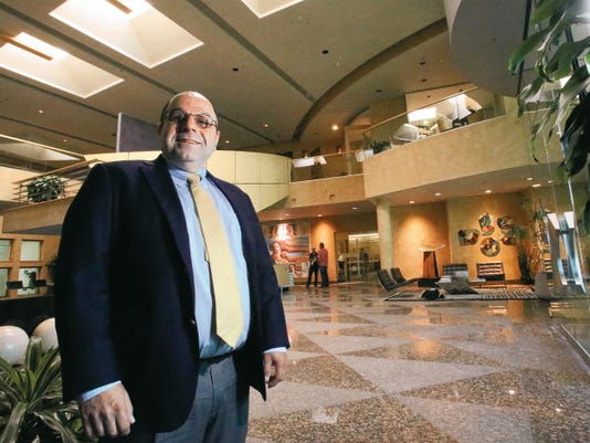 Rudy Gutierrez—El Paso Times Helen of Troy CEO Julien Mininberg stood last week inside the lobby of the company's headquarters building located along Interstate 10 and near Trans Mountain Road in West El Paso.