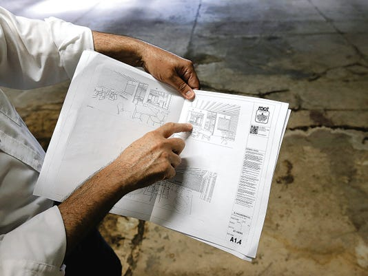 Jorge Guzman shows the architect's plans for El Paso Brewing Company at 810 Texas.