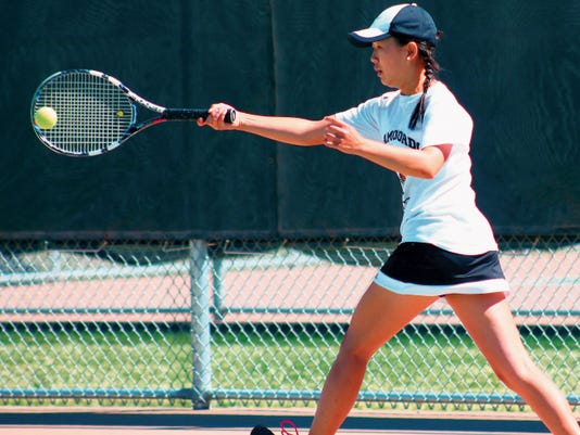 Melanie Jun returns a forehand Tuesday afternoon at the Oregon Courts.