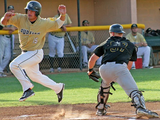 Ben Lott evades the tag from Trinidad catcher Brian Rich on Friday evening at the Griggs Sports Complex.
