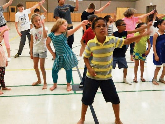 Submitted Photo   Ethan Cruz (foreground) leads dance exercise for students in the Performing Atrts Camp at the First United Methodist Church.