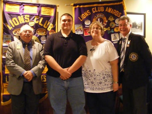 From left, are Past District Governor, Andrew J. DeMario Sr.; Lion Paul Pope III; Lion Secretary, Christy Pope; and District Governor Elect, Robert Mitchell.