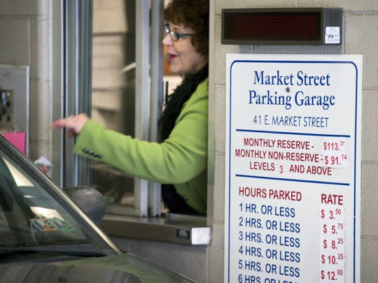 Joy Miller, a York City Parking Bureau employee, works at the Market Street Garage in York. The pricing for the city's three garages has since changed to 2.50 an hour to attract more motorists who otherwise park at metered spaces.