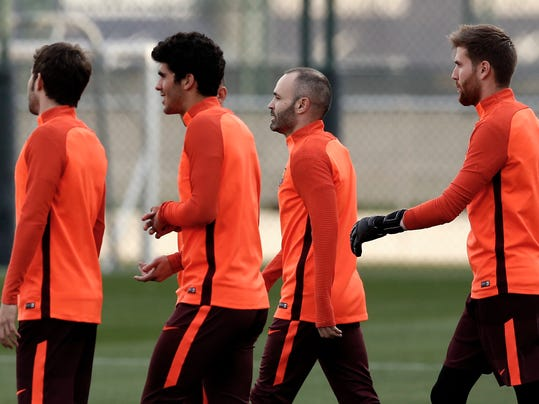 FC Barcelona's Andres Iniesta, second right, attends a training session with his teammates at the Sports Center FC Barcelona Joan Gamper in Sant Joan Despi, Spain, Tuesday, March 13, 2018. FC Barcelona will play against Chelsea in a Champions League round of sixteen second leg on Wednesday. (AP Photo/Manu Fernandez)