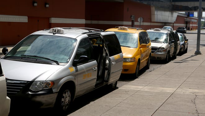 Taxi cabs line up on Brooklyn Street in front of the Motor City Casino Hotel on Aug. 11, 2017.
