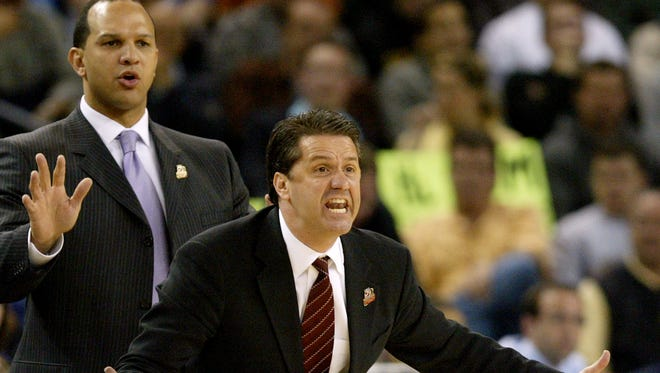 Memphis head coach John Calipari yells instructions to his team in front of assistant coach Tony Barbee during the first half of their NCAA Tournament regional final college basketball game against UCLA, Saturday, March 25, 2006, in Oakland, Calif. (AP Photo/Marcio Jose Sanchez)