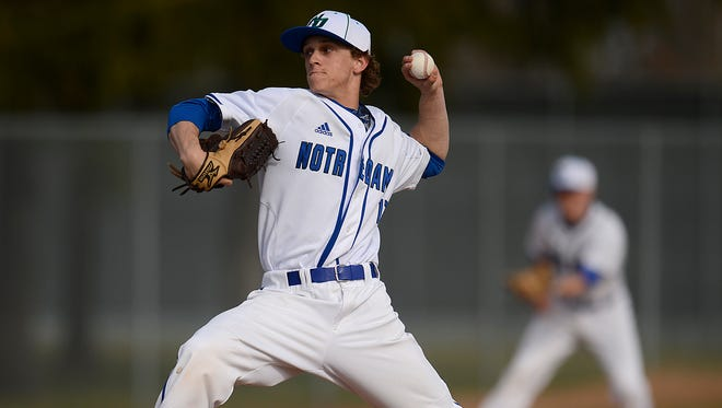 Green Bay Notre Dame pitcher Eric Erb (12) gets ready to fire a pitch in the first inning during Tuesday's baseball game against Manitowoc at Green Bay Notre Dame Academy in Green Bay. Evan Siegle/Press-Gazette Media