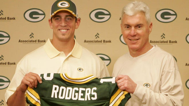 Green Bay Packers general manager Ted Thompson (right) stands next to quarterback Aaron Rodgers during a news conference at Lambeau Field on April 24, 2005. Rodgers, a two-time NFL MVP who led Green Bay to a championship in Super Bowl XLV, was Thompson's first draft choice as the Packers' GM.