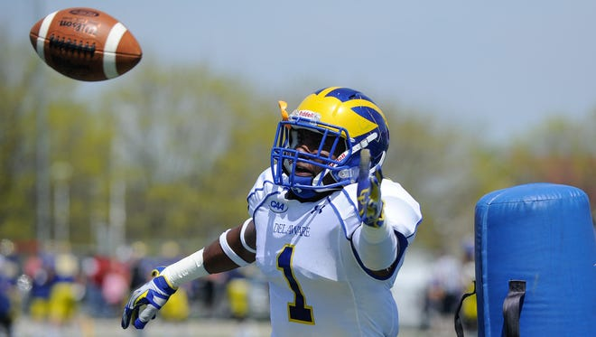 The University of Delaware's Malcolm Brown reaches for a pass Saturday at the annual Downstate Day scrimmage at Smyrna High School.
